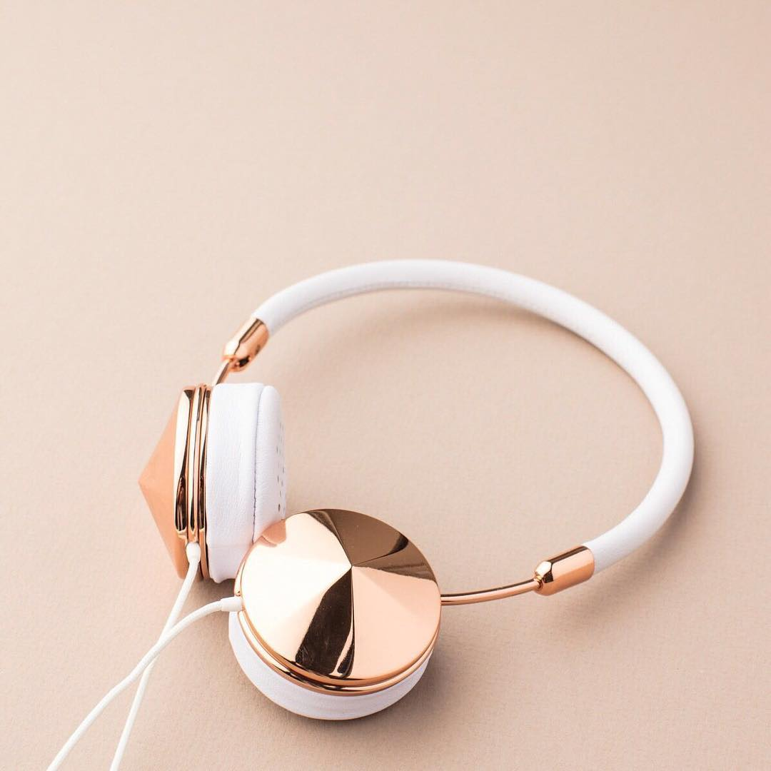 pair of headphones with rose gold detail