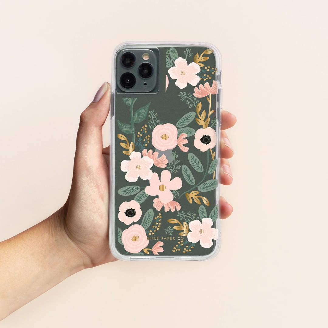 hand holding iPhone 11 with floral phone case
