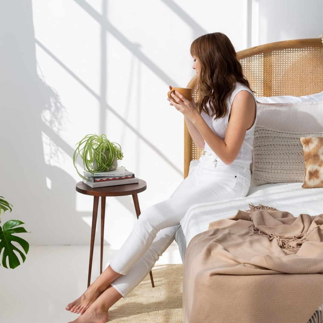 woman leaning on bed to relax after work